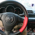 A tan interior always begs for red trimmed steering wheel